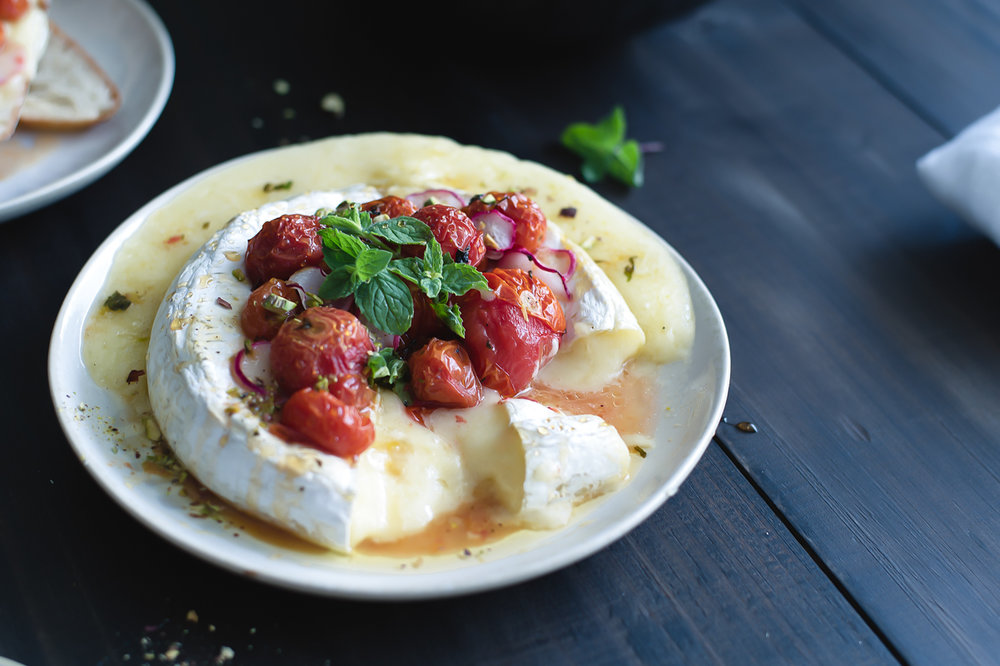 A delicious baked Brie with roasted tomatoes and honey.  The perfect light meal for summer.
