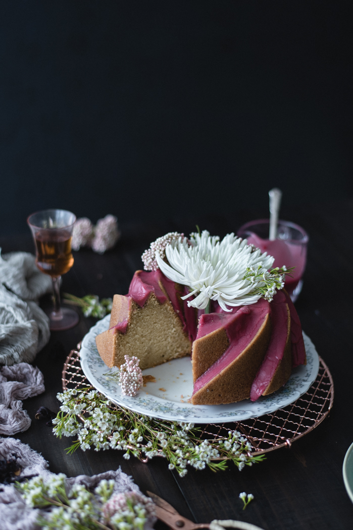 Coconut Bundt Cake with Hibiscus Glaze - Coconut CakeCoconut oil – 1 cupRaw sugar, pulsed for a few seconds through a Nutri-bullet or food processor – 2 cupsUnbleached all purpose flour – 3 cups + 2 TBSPBaking soda – 1 TspMedium to large eggs – 4Coconut extract – 1 TBSPVanilla extract – 2 TspFine sea salt – 1 ½ TspCoconut milk – 1 ½ cupCooking or baking spray to coat the panHibiscus GlazeDried hibiscus flowers – 1/4 cupWater – 1/2 cupConfectioner's sugar – 1 cups+Simple syrupRaw sugar – ¾ cupWater – ⅔ cupVanilla paste or extract – 2 TspFine sea salt – ¼ Tsp