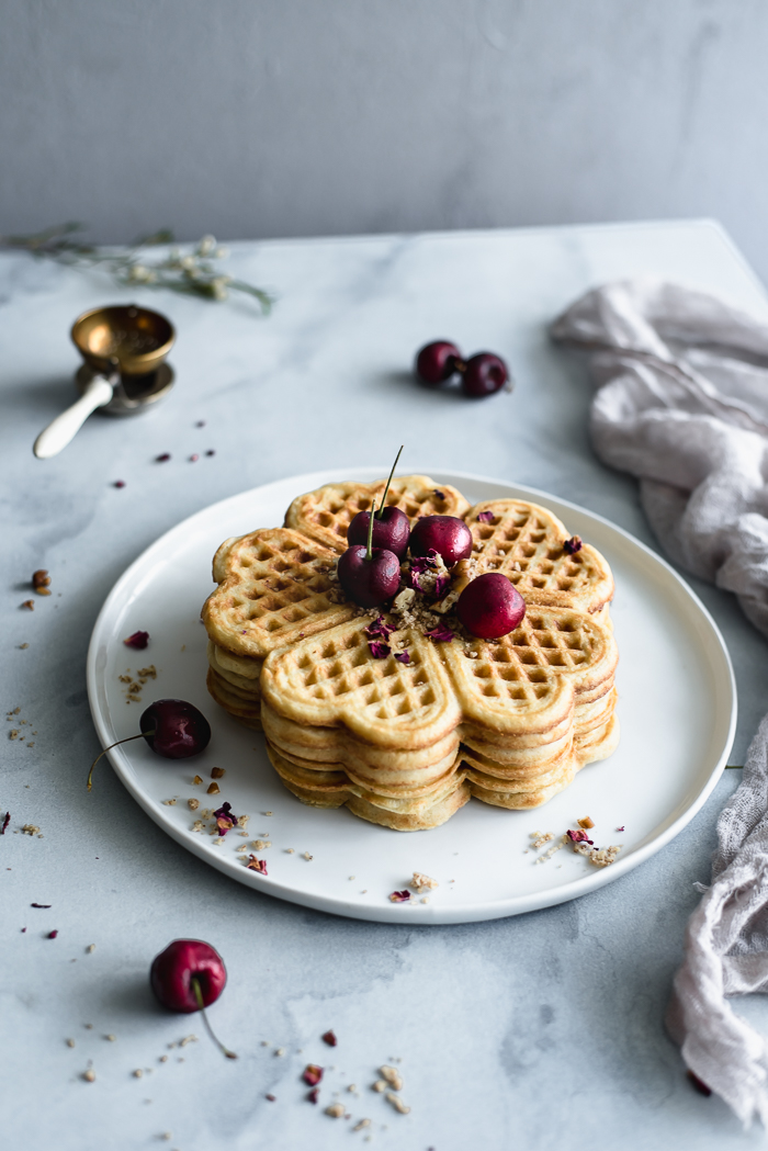 Vanilla Yeasted Waffles - Milk – 2 ½ cup (see notes)Water – ¼ cupUnsalted butter, cut into cubes – 1 stick (8 TBSP; ½ cup) plus more melted for cooking the wafflesRaw sugar – 1 ½ TBSPFine sea salt – 1 ½ TspUnbleached all-purpose flour – 2 ¾ cupsBaking soda – ¼ TspBaking powder – ¼ TspPure vanilla paste or extract – 1 TBSPEggs, beaten and at rom temperature – 2 largeActive dry yeast – 1 package (2 ¼ Tsp approximately)