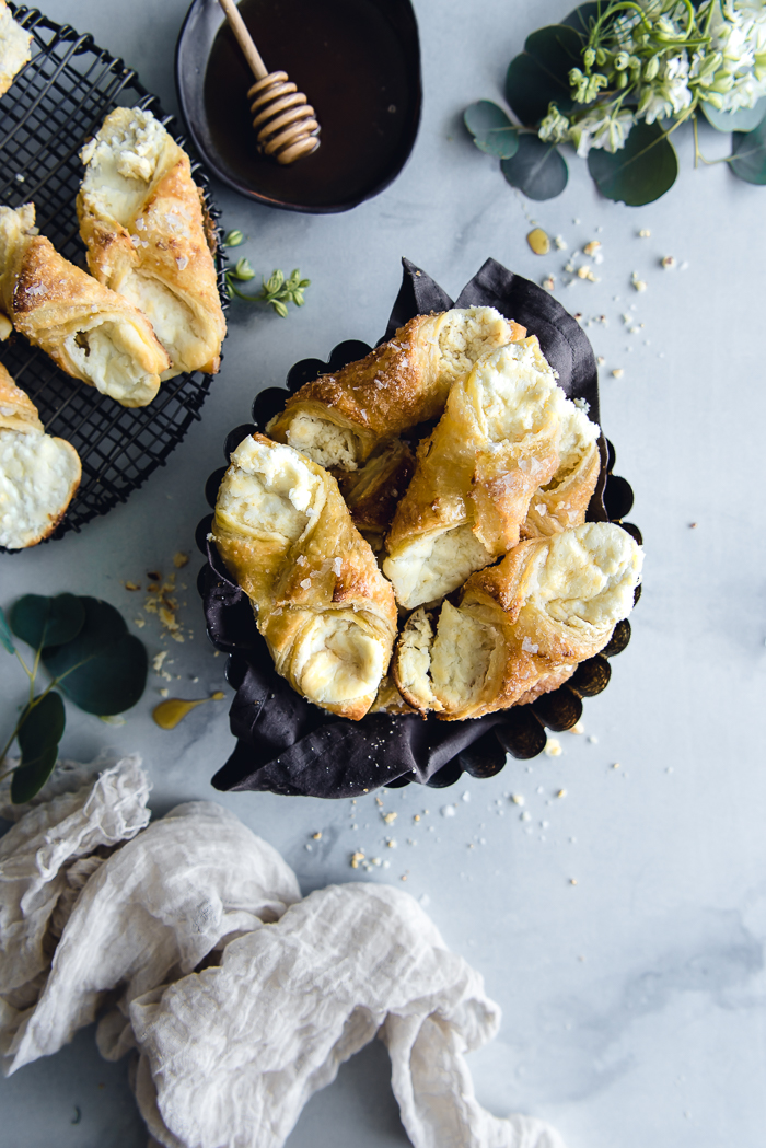 Three Cheese Quesitos - Cream cheese, room temperature – 8 oz (1 box)Ricotta cheese – ¼ cupMascarpone cheese – 4 oz (about half of an 8 oz container)Raw sugar – 10 TBSP, dividedFine sea salt – ¼ Tsp + more to sprinkle on topFreshly squeezed lemon juice – ½ lemonPuff pastry, thawed – 1 boxEgg – 1Honey, light corn syrup or both – a couple of tablespoons