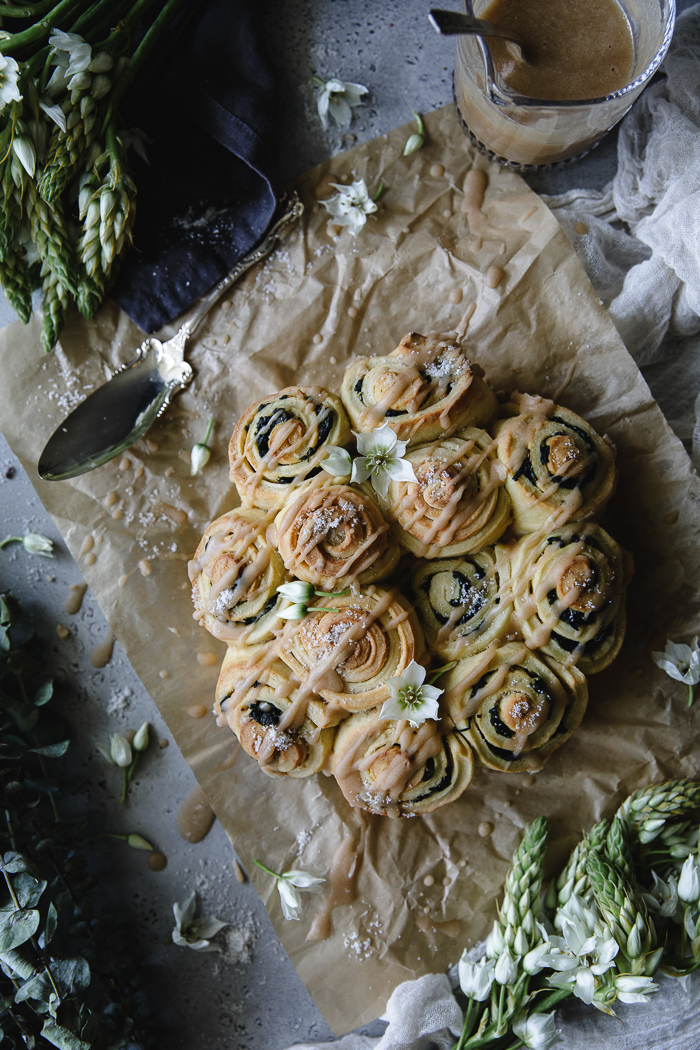 Sweet Spinach, Garlic, Maple and Pistachio Rolls - DoughActive dry yeast – 1 Tsp. (1 packet)Warm water – ½ cupAll purpose unbleached flour – 3 ¼ cupEggs, room temperature – 3Raw sugar – 3 TBSPFine sea salt – 2 TspUnsalted or regular butter, at room temperature – 7 TBSPFillingButter – 1 TBSPRaw sugar – 3 TspOlive oil – 2 TBSPFresh spinach leaves – 4 cupsGround garlic – ¼ Tsp or a bit more to tasteChopped pistachios – 2 TBSPMaple syrup – 1 or 2 TspFine sea salt – a good pinchGlaceMaple syrup – ½ cupButter – 3 TBSPConfectioner's sugar, sifted – 1 cup