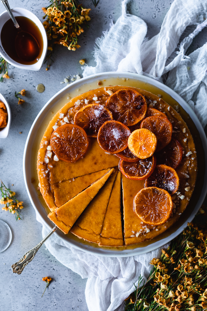 Pumpkin Cheescake with Candied Oranges - CrustTraditional graham crackers – 8 oz (15 whole rectangular cookies), broken in small piecesUnsalted butter – 8 TBSP (1 stick)Ground cinnamon (optional) – ½ TeaspoonFine sea salt – ¼ TspPumpkin FillingCream cheese, at room temperature – 4 ½ boxes of 8 ozRaw sugar – 1¾ cupPumpkin purée – 1 ½ - 15 oz canUnbleached all purpose flour – 7 TBSPLemon juice – 1 TBSP, about the juice of 1 medium lemonFresh grated ginger (optional) – 2 TBSPPure vanilla extract – ½ TspFine sea salt – ¼ TspEggs – 5, largeEgg yolks – 2, from large eggsCaramel SauceRaw sugar – 1 cupDark brown sugar (see notes) – ½ cup Water – ¼ cupOrange zest – 1 TBSPFreshly squeezed orange juice – ¾ cupCandied OrangesMandarin oranges – 3 to 4Water – 2 cupsRaw sugar – 2 cups + extra to sprinkle on top (if desired)