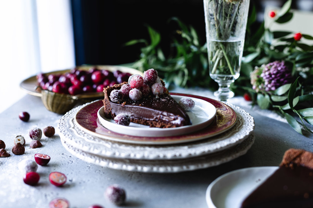 A super easy chocolate tart covered with sugared cranberries