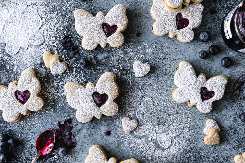 Sugar cookie sandwiches filled with blueberry