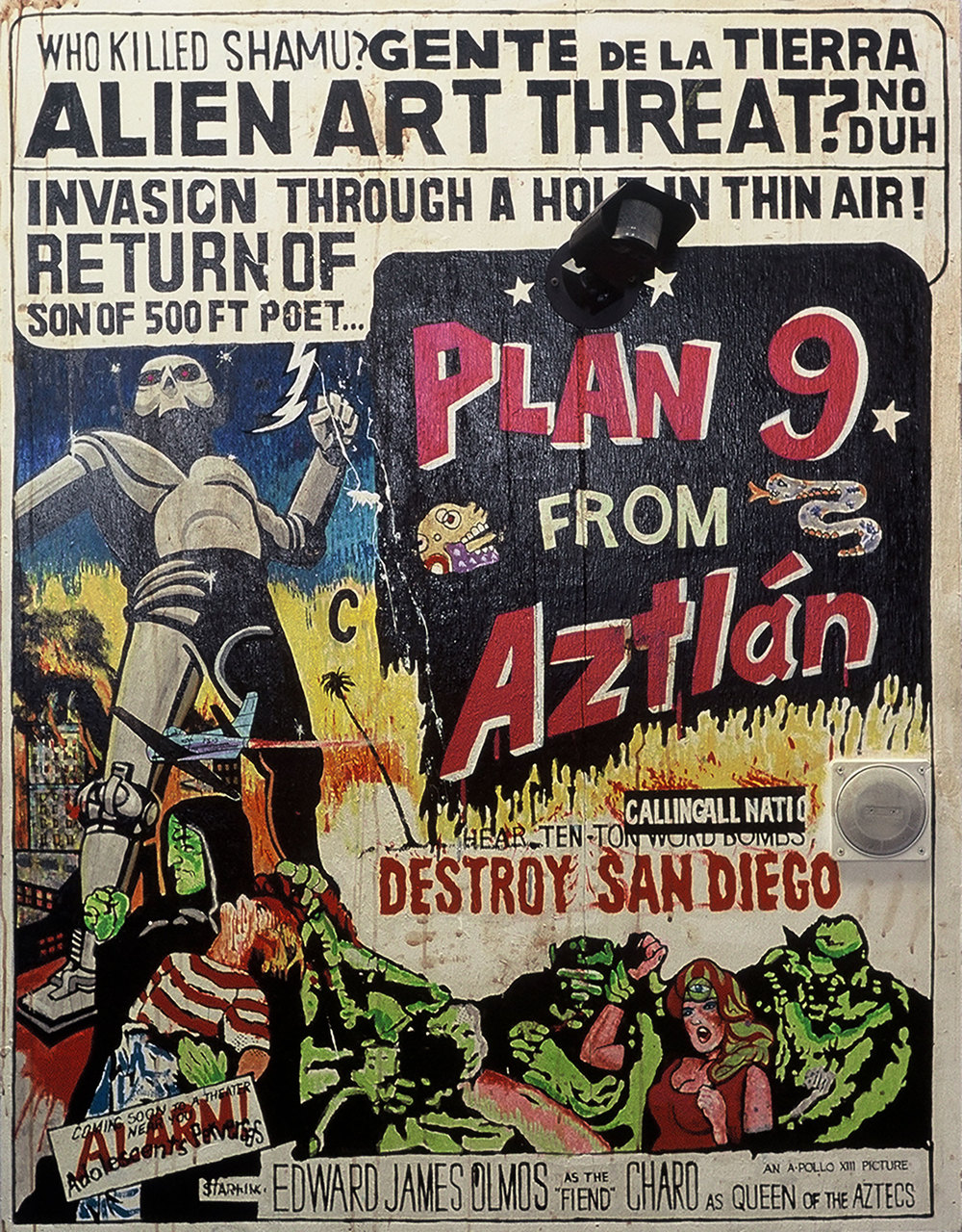 "Title: Plan 9 from Aztlan   Dimensions: 40"" x 60"" Medium: Acrylic on wood, tape loop, motion detector Date: 2000 Notes: The anti-immigrant political climate of California in 1997 inspired this painting. References to B-movies are given more resonance by the knowledge that the ""plan"" has also existed as a form of manifesto throughout Chicano history. The message here was to resist the anti-immigrant politicies of then California governor Pete Wilson. Like other paintings of this time, the visual message was augmented by a soundtrack recorded on a tape loop and embedded in the picture frame."