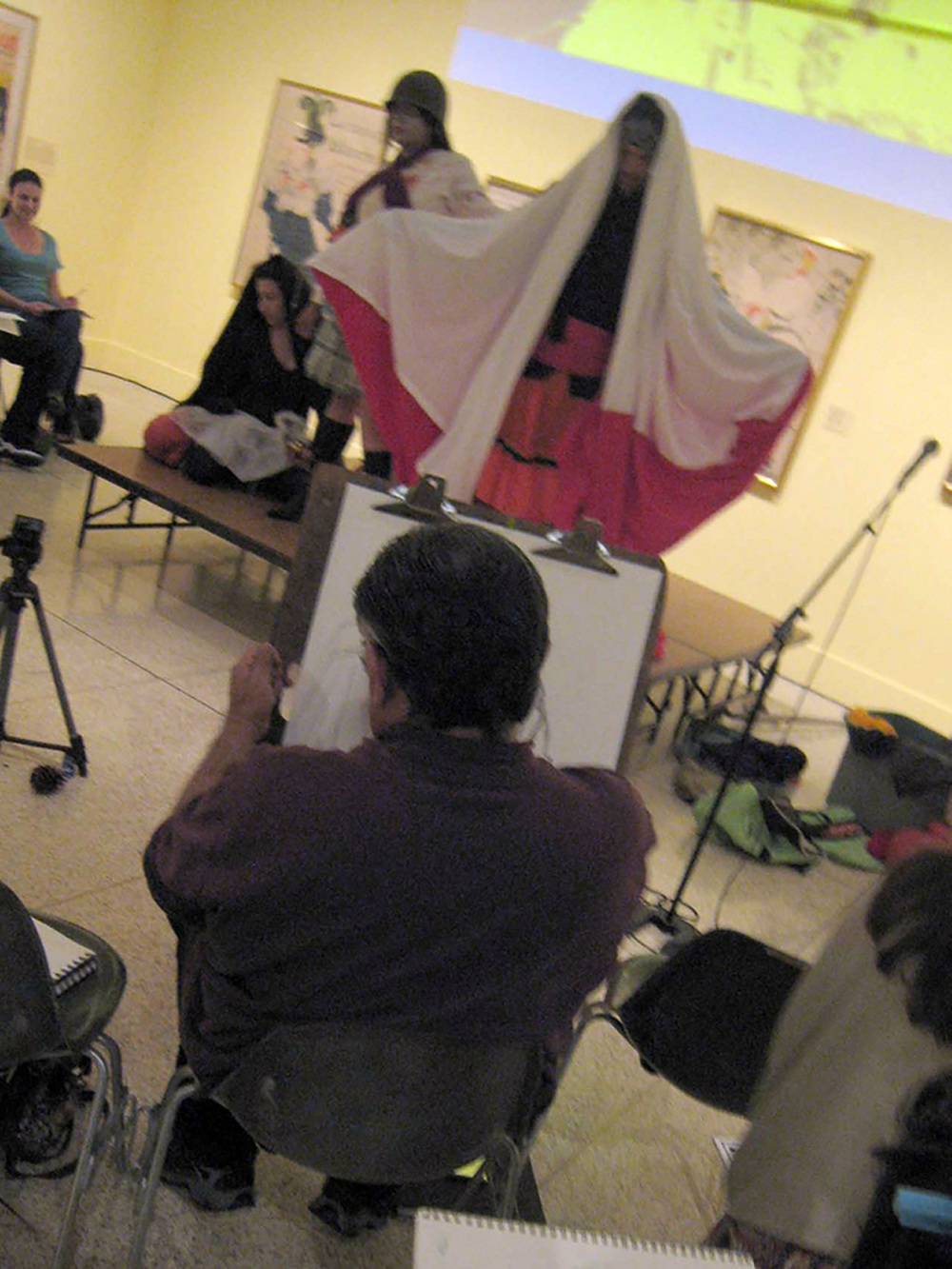 Title: LaVidaDrawingAktion  Medium: Multimedia performance Date: September 2010 Notes: A life drawing class serves as the framework for exploring 19th century ideas of race, ethnography and  el mestizaje.