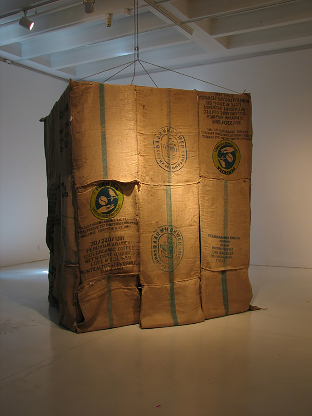 Title: Mexus Sexus Fluxus  Medium: Multimedia performance Date: April 2011 Notes: Installation view of Colonial Bagism, a structure made out of coffee bags featured as a part of Mexus Sexus Fluxus.