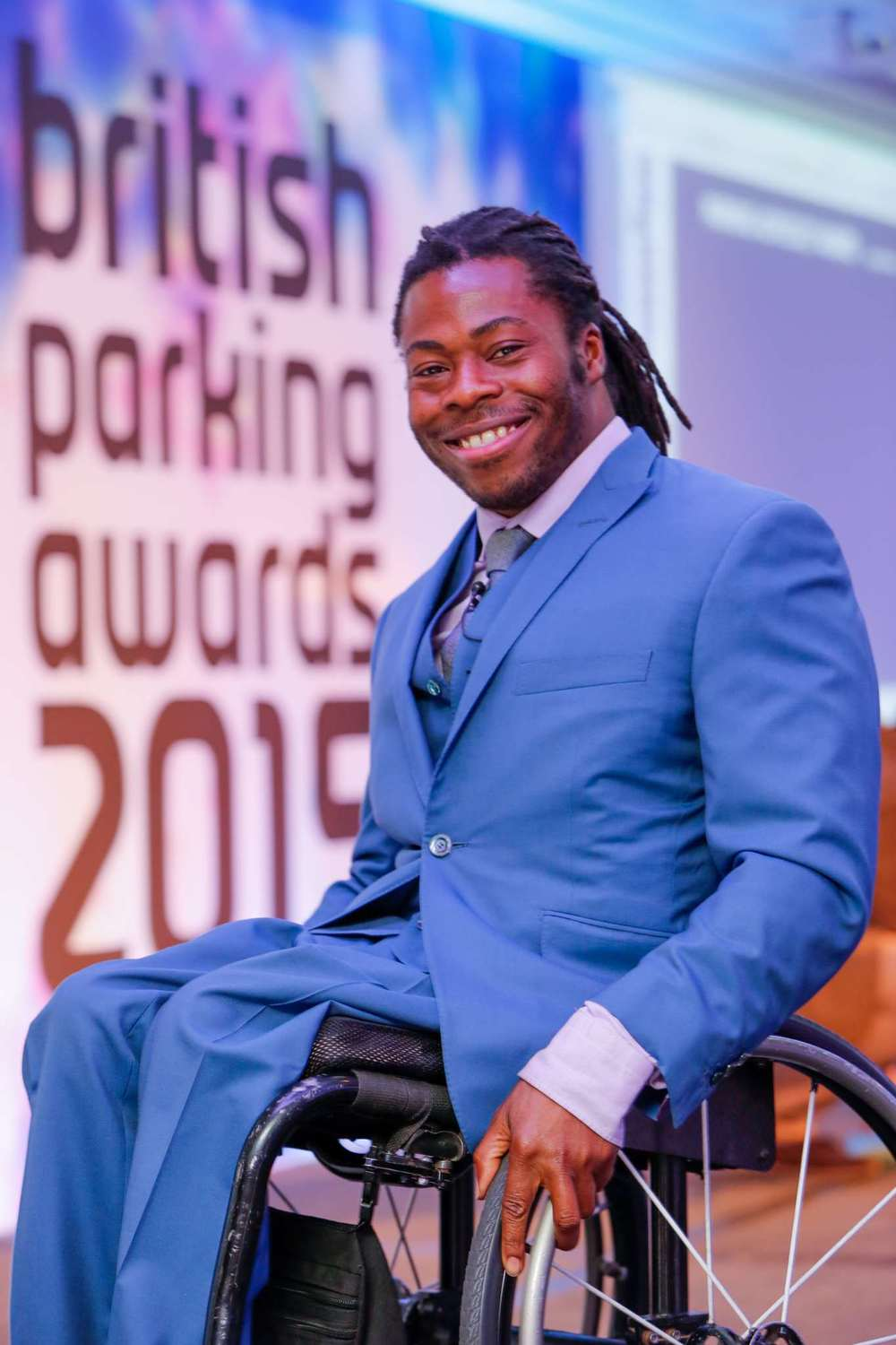 Television presenter and wheelchair basketball playerAde Adepitan presented the Sustainable Parking Award to FES Commercial Director Marcus Brodin.