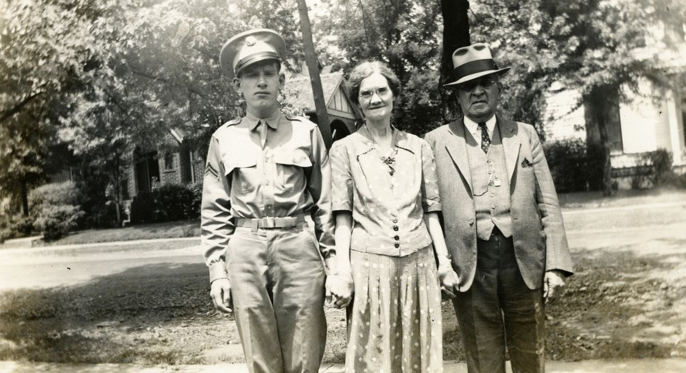James Henry Kilgore., 1942 (age 23) in uniform preparing to serve in WWII in Italy. Mr. Kilgore is shown here with his mother, Irene Watkins Kilgore and his father, James Henry Kilgore Sr.