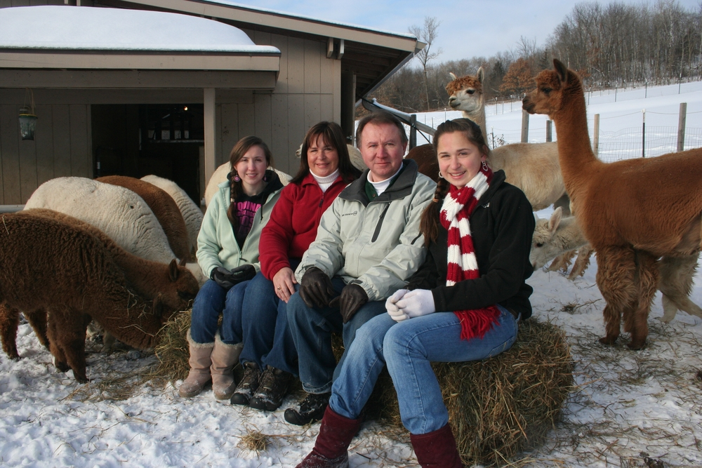 family with the alpacas