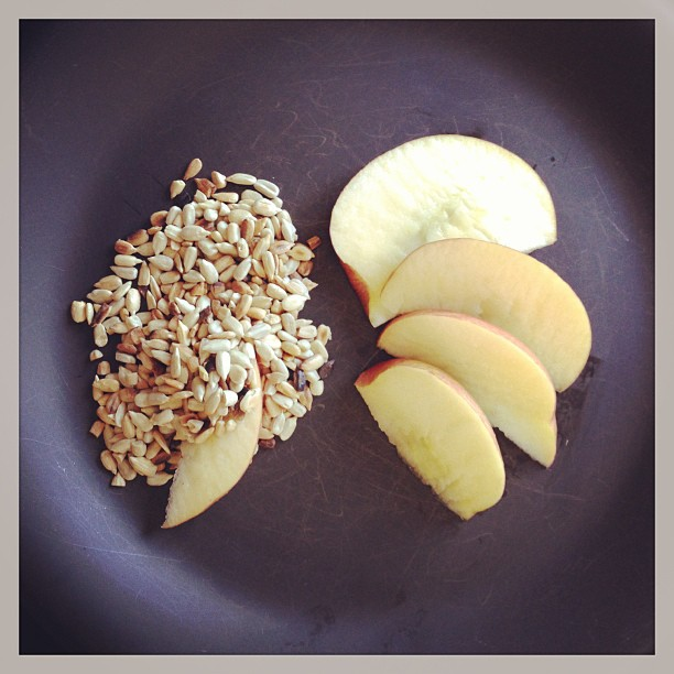 One of my favorite healthy afternoon snacks (especially when craving Sweet and Crunchy).  Lightly toast raw sunflower seeds. (4 tbs. of seeds have 90% of daily Vit E and rids body of free radicals).  Thinly Slice an apple– and dip;)