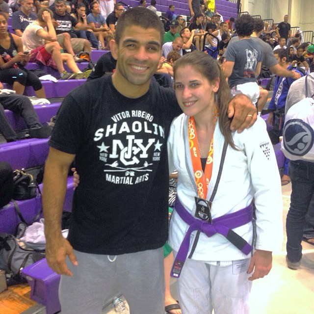 Hannah is posing with legend Vitor Shaolin