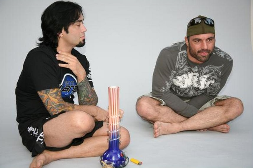 Eddibe Bravo and Joe Rogan with a Bong used to smoke Cannabis