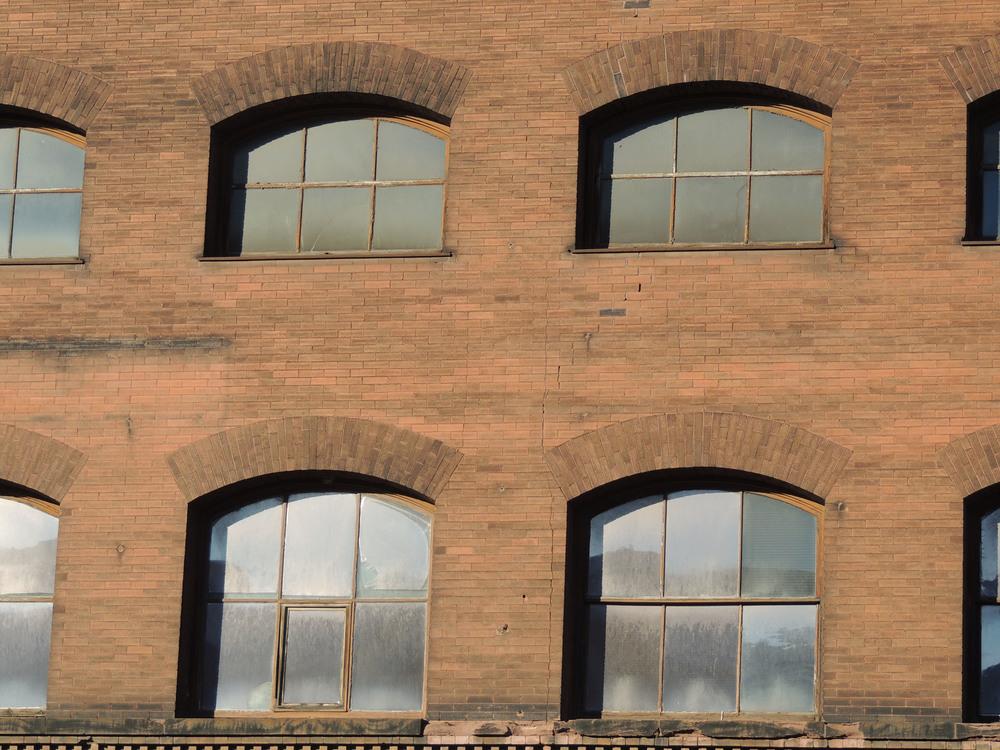 Above:  Unique window structures for unique rooms.