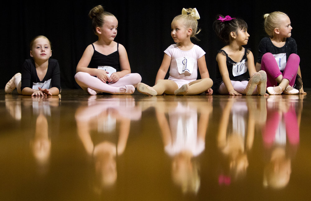 Young girls ages five and six wait for their turn to audition as mice Thursday, Sept. 7, 2017, during auditions for the Eugene Ballet Company's The Nutcracker at the College of Southern Idaho Fine Arts Auditorium in Twin Falls.
