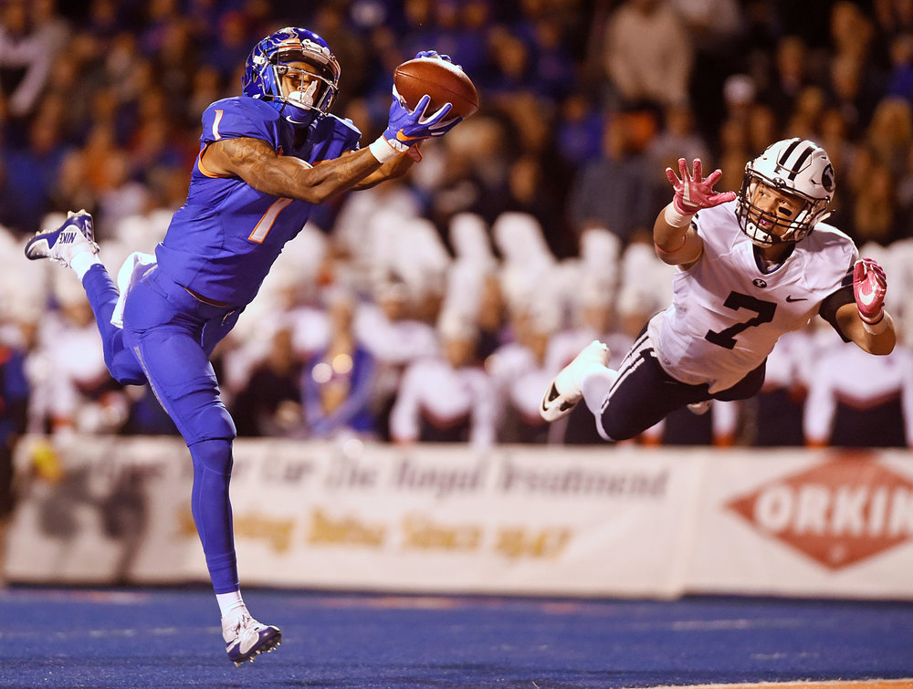 Boise State wide receiver Cedrick Wilson (1) catches a deep throw for a touchdown before BYU defensive back Micah Hannemann (7) can intercept it Thursday, Oct. 20, 2016, at Albertsons Stadium in Boise, Idaho.