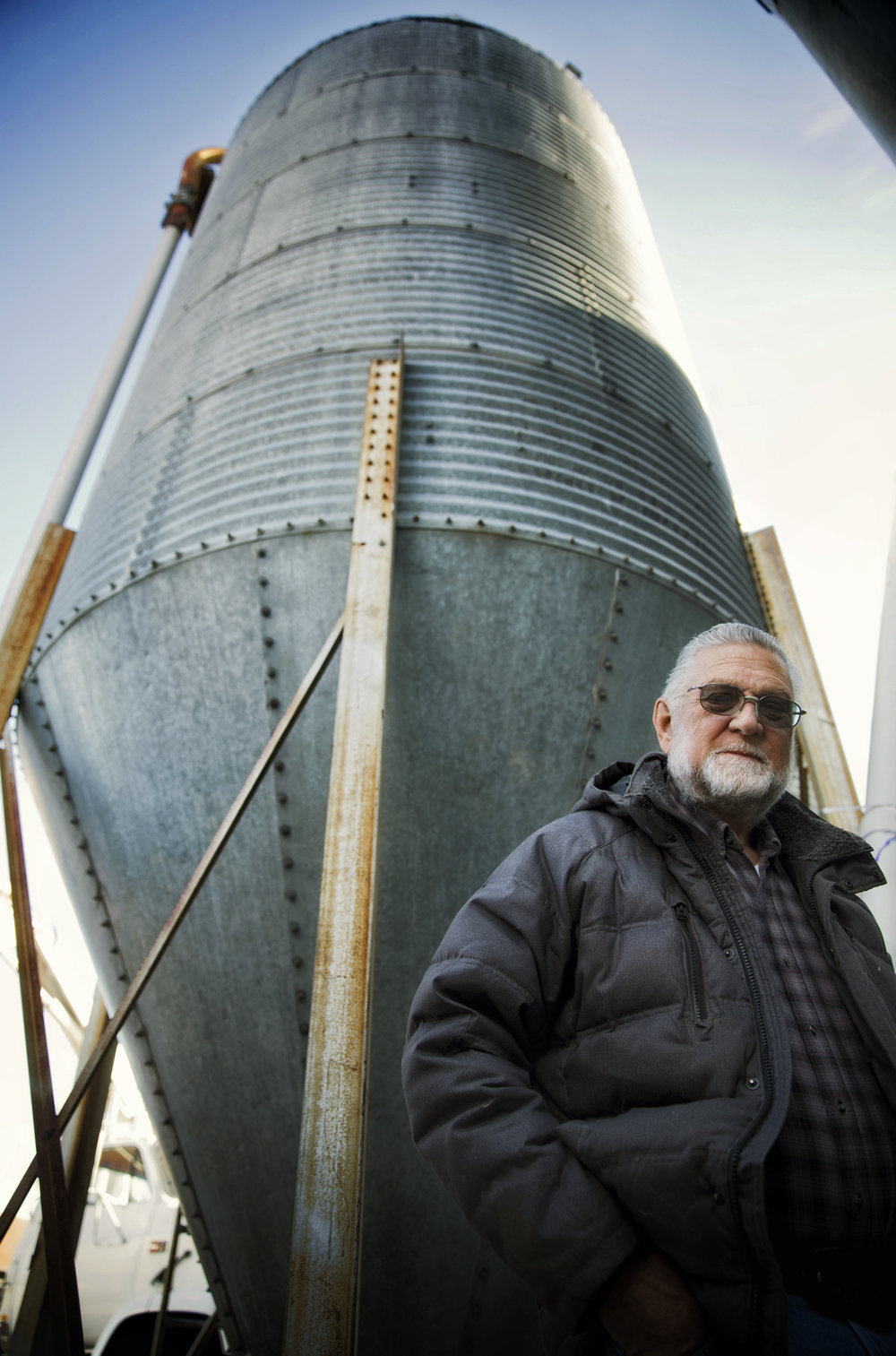 Owner Leo Ray stands next to one of the feed bins Thursday, March 9, 2017, at Fish Breeders of Idaho in Hagerman Idaho. Ray's business is installing a new extruder machine to produce their own fish feed in hopes of lowering production costs. Over the past 20 years the price for feed has more than doubled for Ray. 'There's a world shortage of fish meal,' he says. 'Fish meal is basically the trash fish of the ocean. In the last 10 years, the amount of fish meal harvested has leveled off.'
