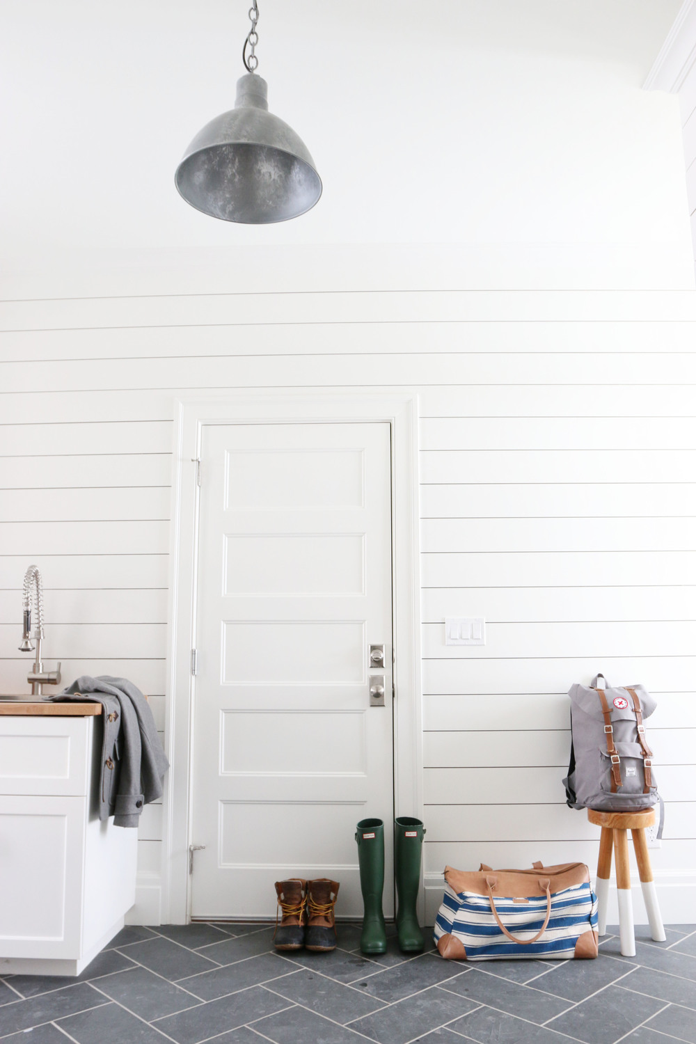 Mudroom with shiplap and slate herringbone floors || Studio McGee