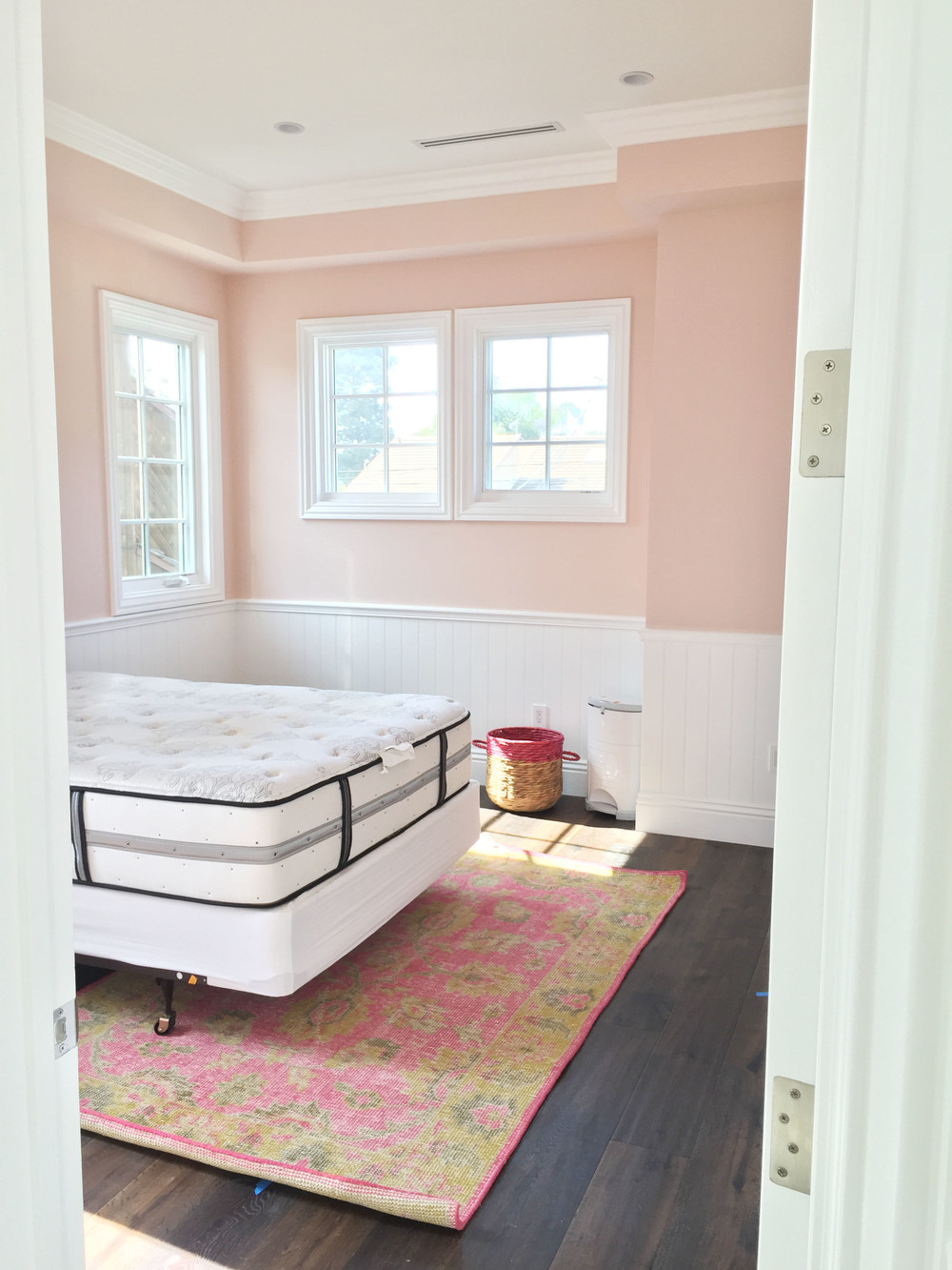 "Benjamin Moore ""Love & Happiness"" is the perfect name for the paint in this little girl's room."