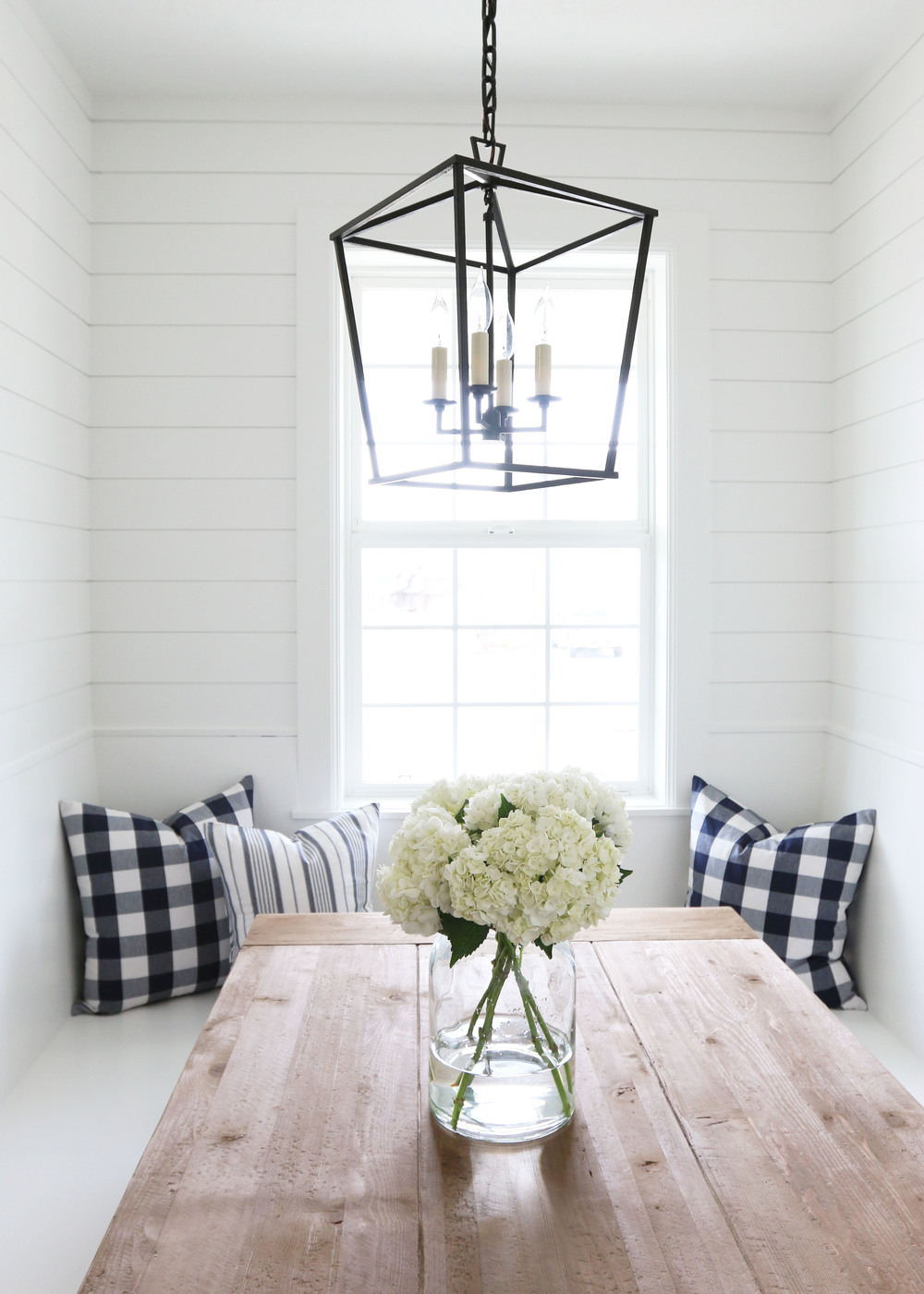 Farmhouse table with lantern and shiplap walls || Studio McGee