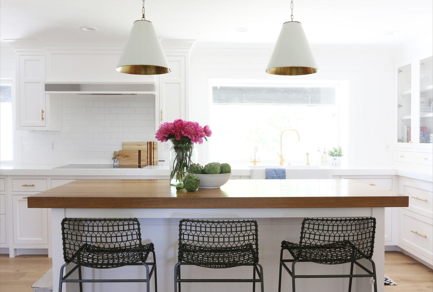 Studio McGee's latest Remodel! White kitchen, brass hardware and a butcher block island.
