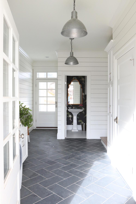 Slate herringbone floors and shiplap walls