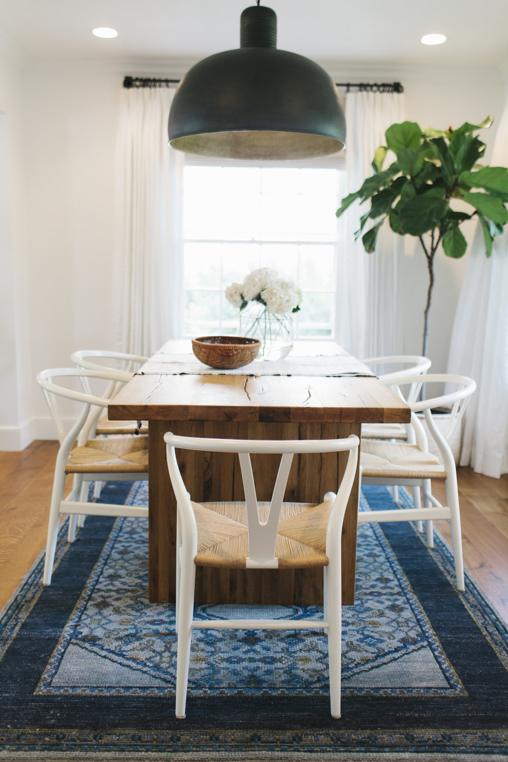 Wishbone chairs and navy rug || Studio McGee