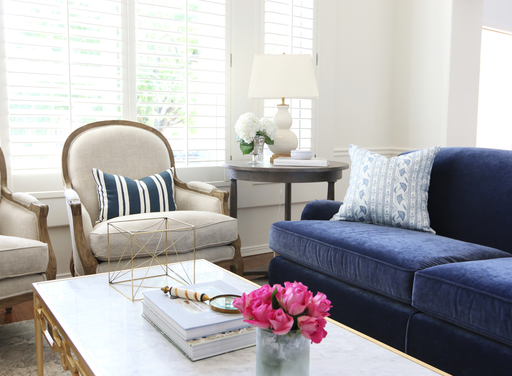 Blue couch with round end table