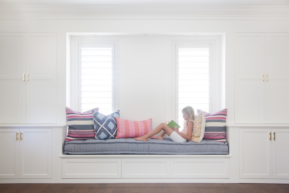 Built-in window bench with decorative pillows