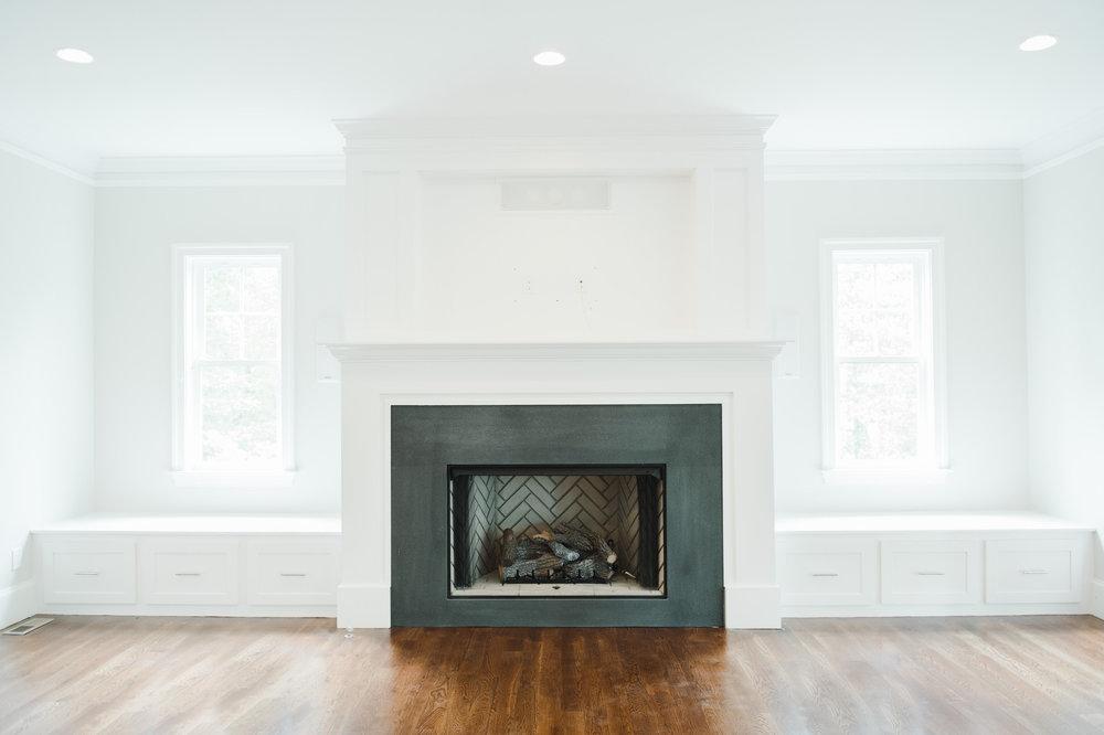Fireplace design with black honed granite and herringbone firebox    Studio McGee