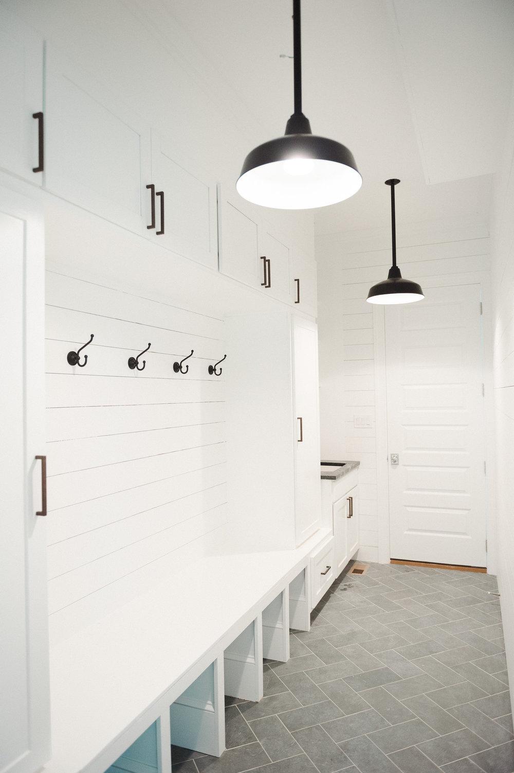 Slate Herringbone Floors, Shiplap and black barn pendants in the mudroom    Studio McGee