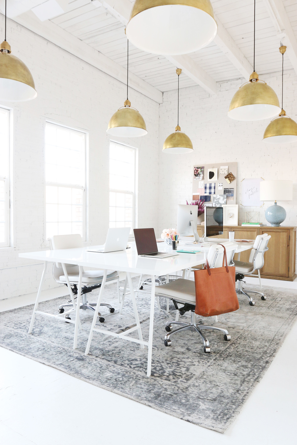 Studio office design with white work table