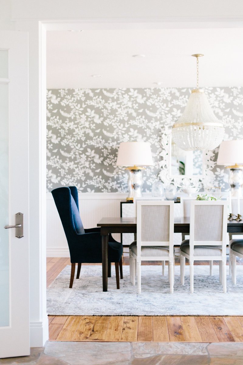 dining room with navy wingback chairs and gray floral wallpaper studio mcgee