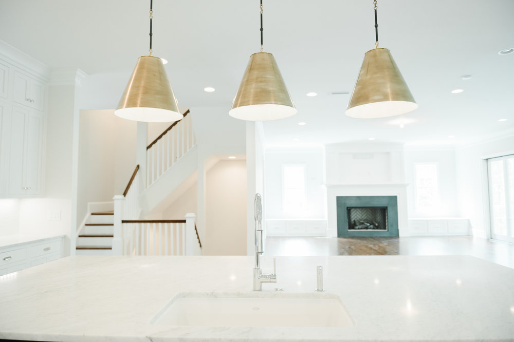 Marble counter top with overhanging lamps