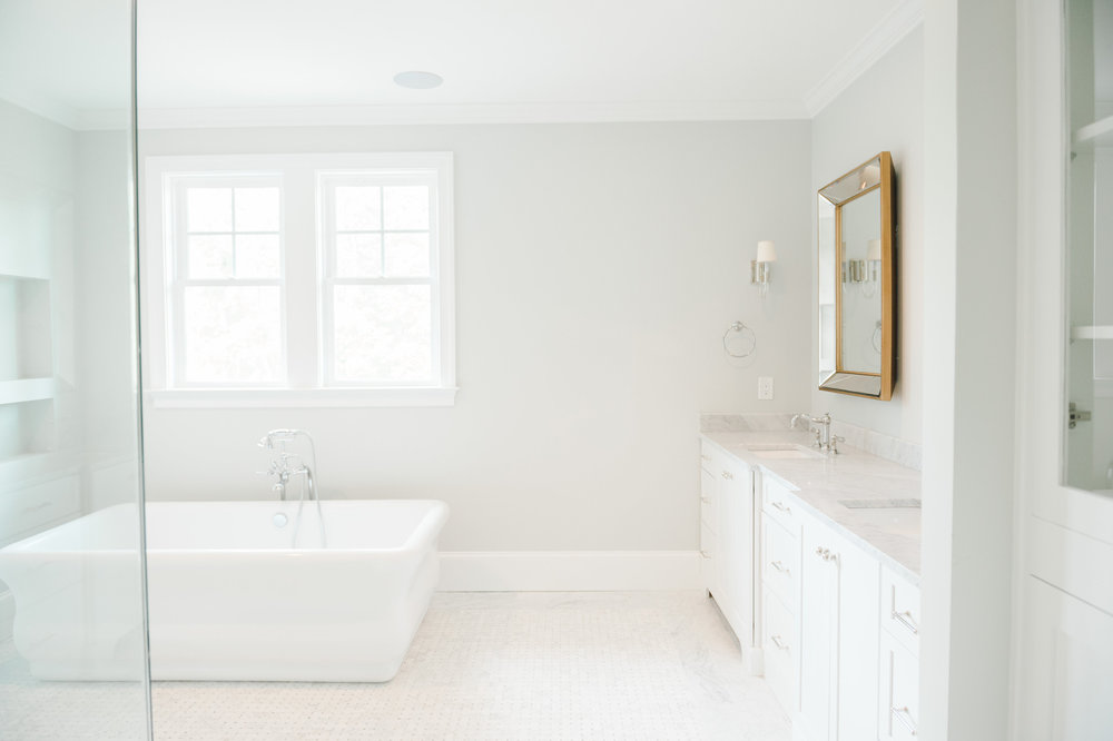Renovated master bath with freestanding tub and double sink