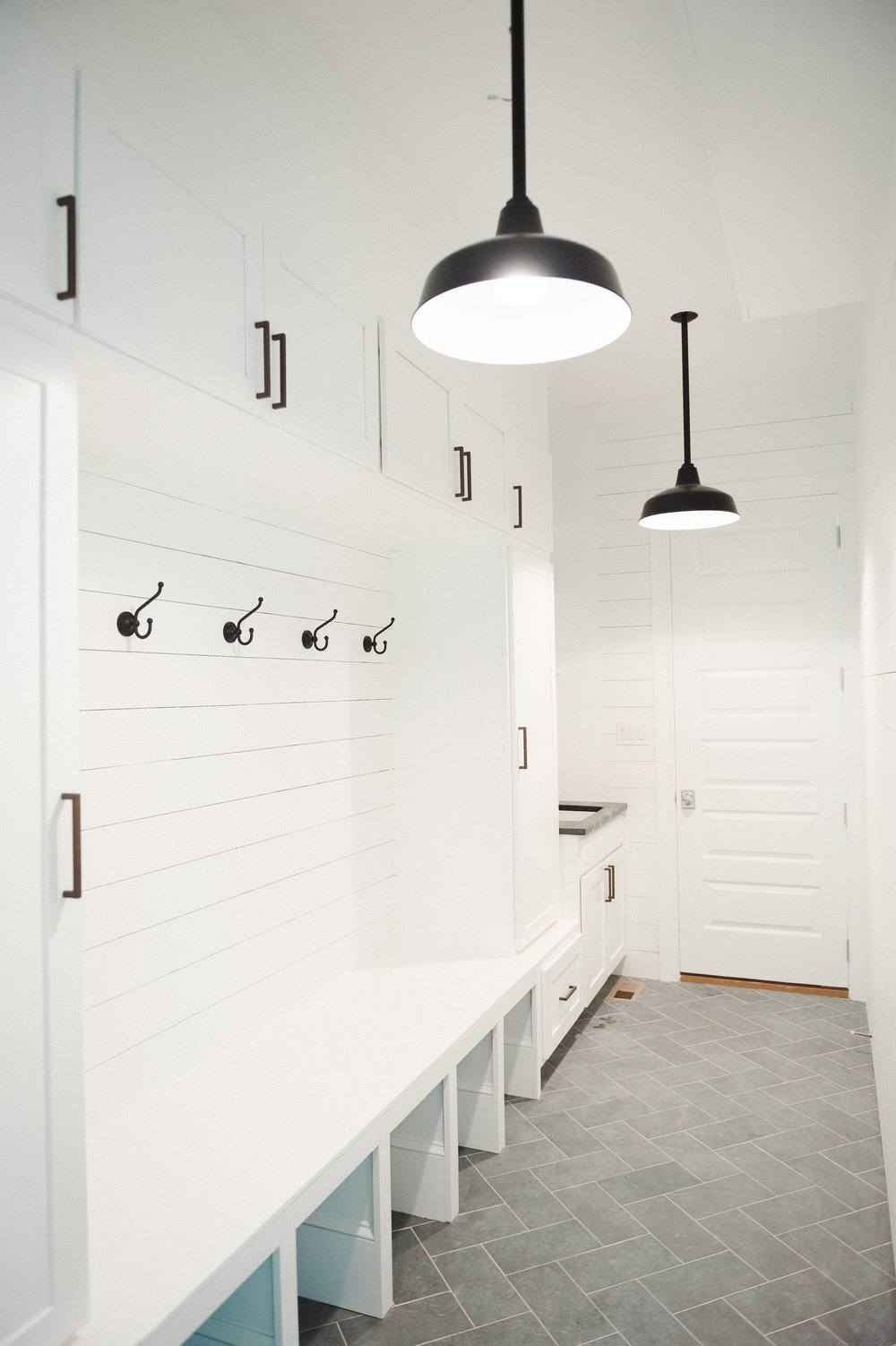 Renovated entry way with built-in coat hangers