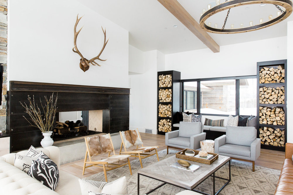 Fireplace and antlers in modern living room