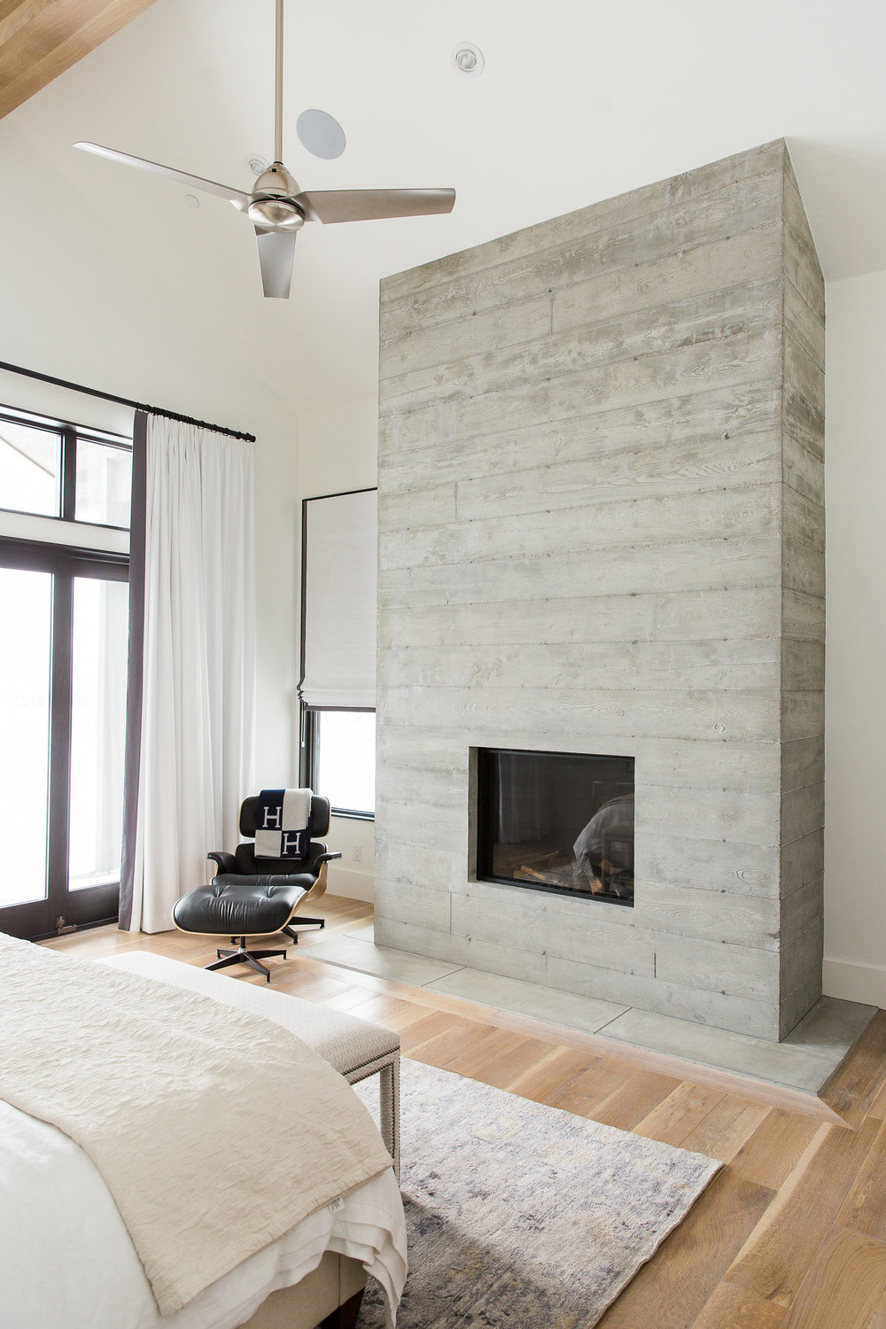 Grey minimalist fireplace in master bedroom