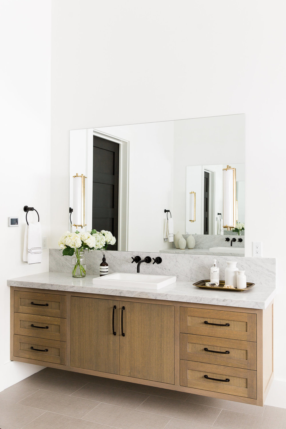 Wooden bathroom vanity with white countertop