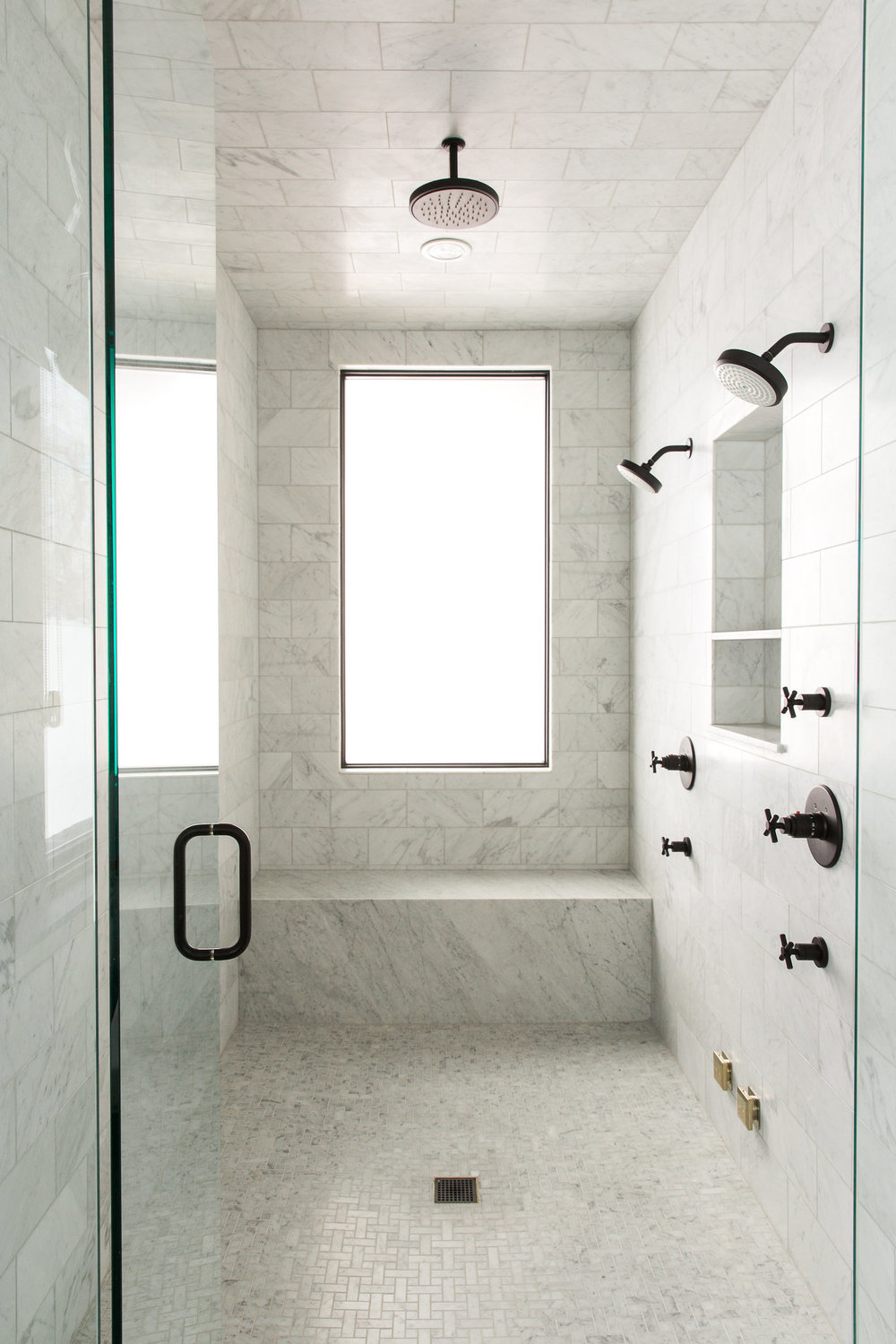 Open glass door to large standing shower