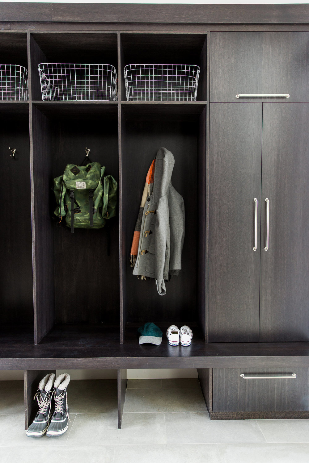 Backpacks and jackets hanging in mudroom