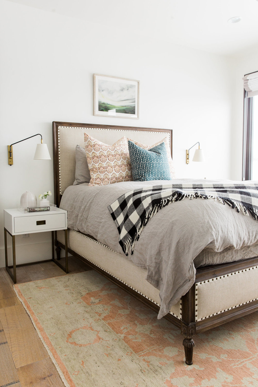 Twin bed with large headboard in bedroom