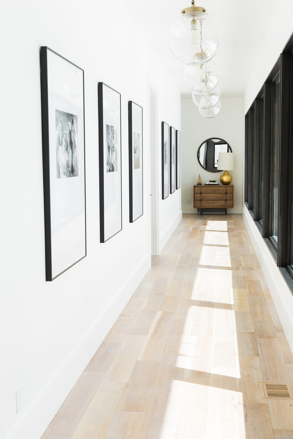 Long hallway with wooden floors