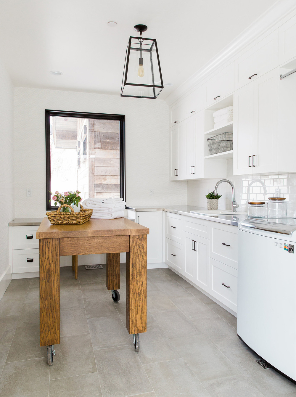 White modern kitchen with wooden cutting table