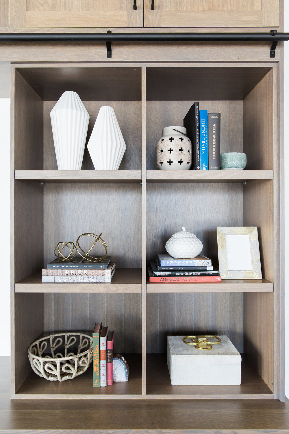 Decorative details on wooden shelving unit