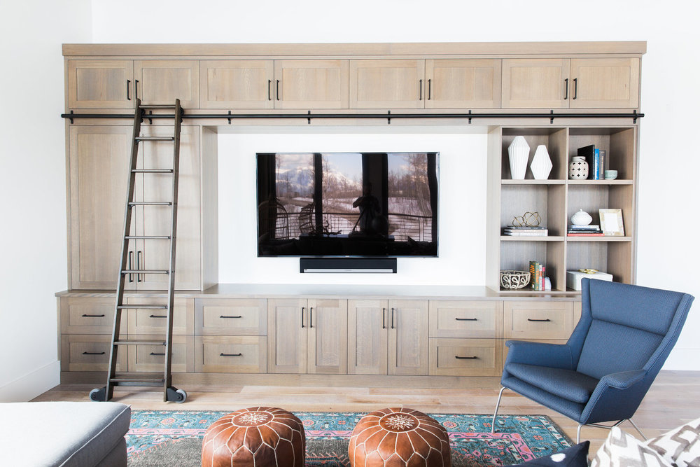 Wooden shelving unit around flat screen TV