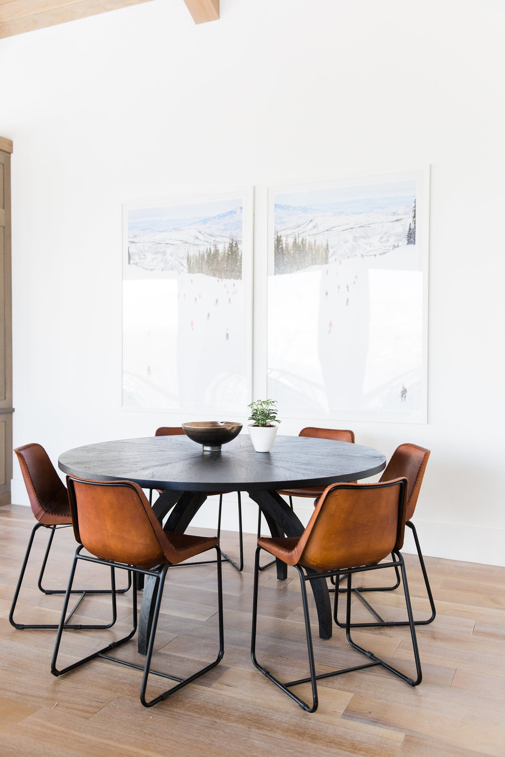 Round dining table with orange chairs