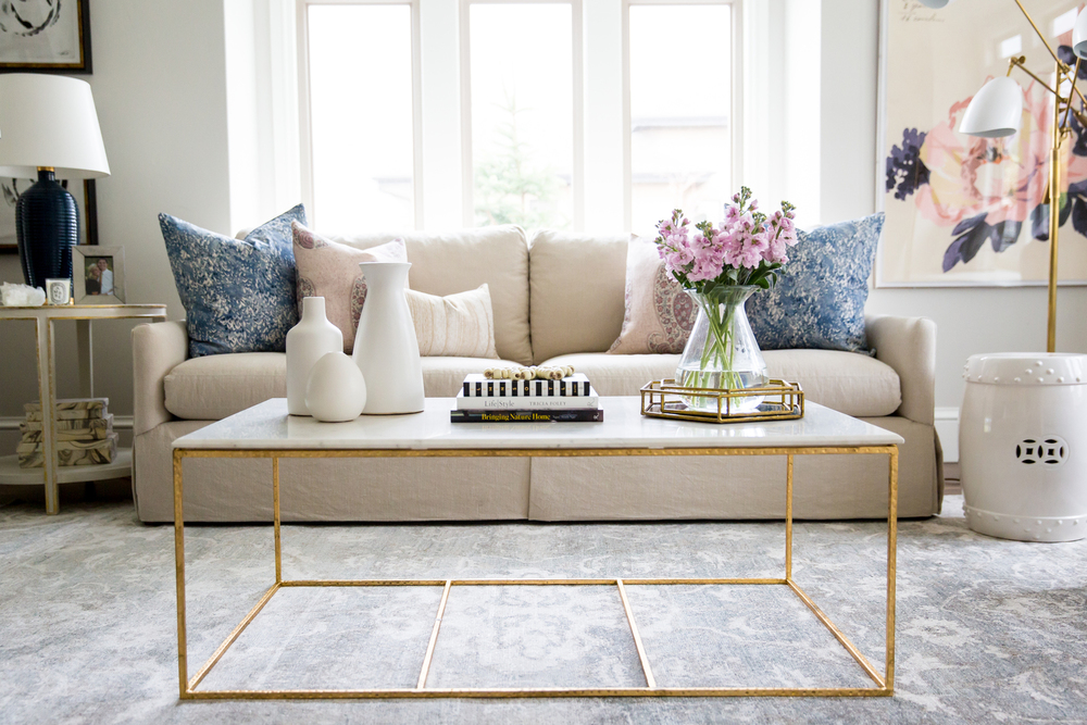 Glass and gold coffee table in living room