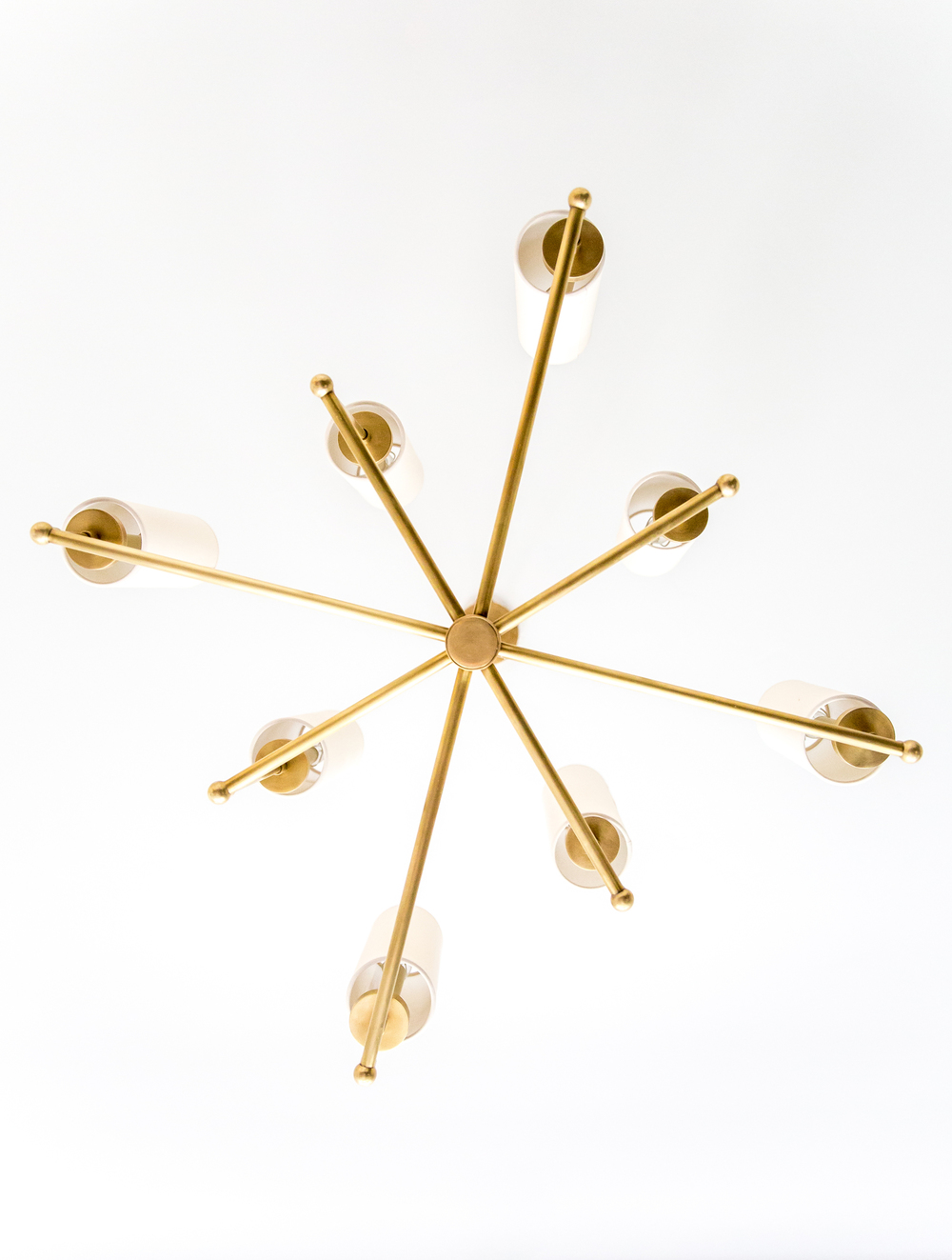 Modern, gold metal chandelier in office