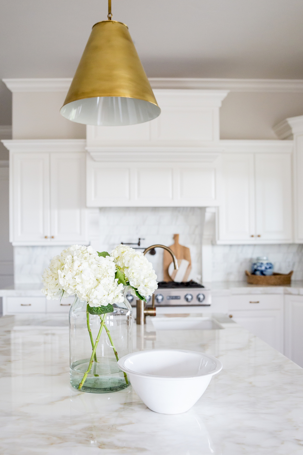 Gold light pendant above kitchen island